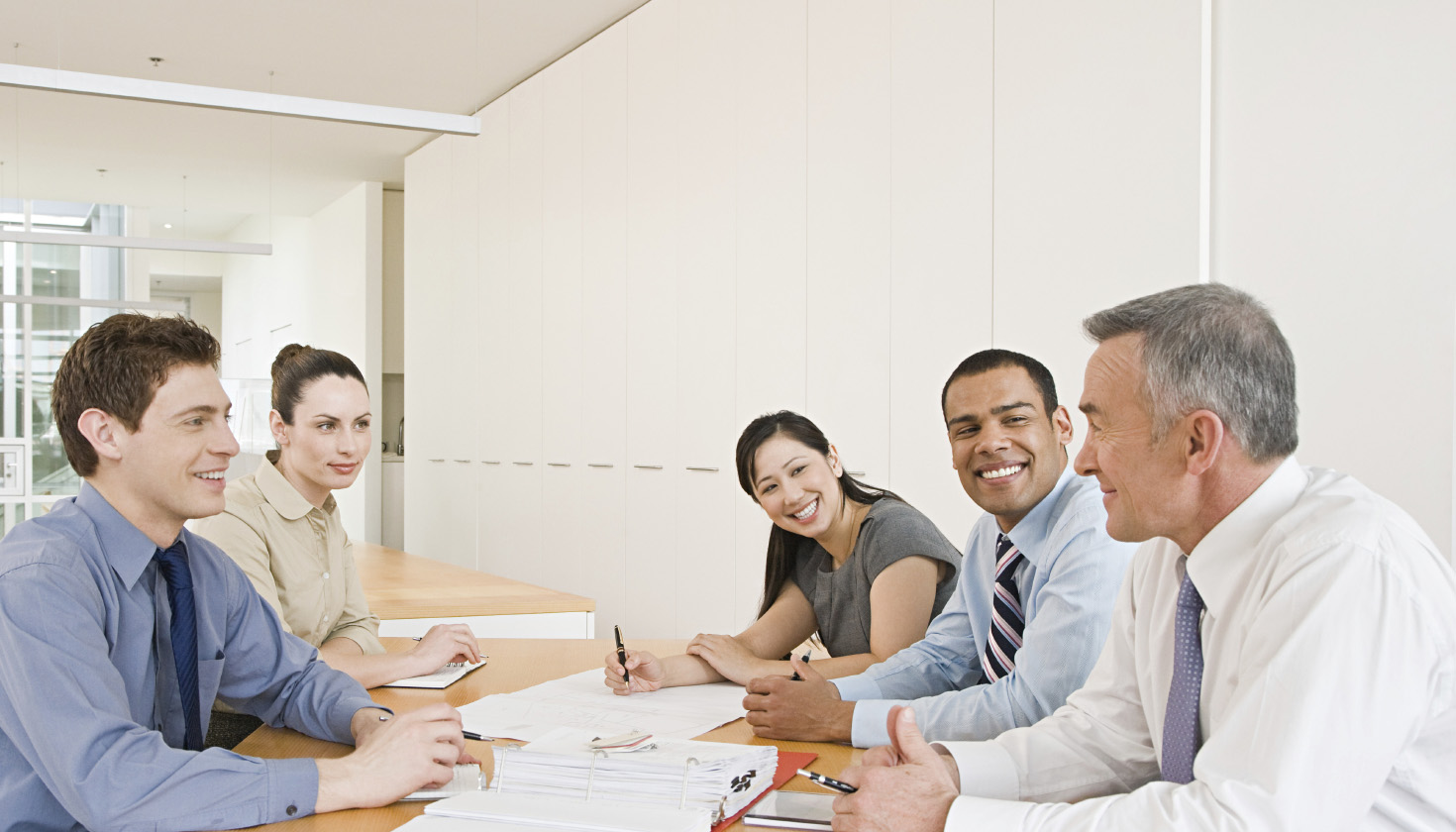 Five businesspeople in a meeting